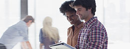 Customer satisfaction management-satisfied customers looking at tablet